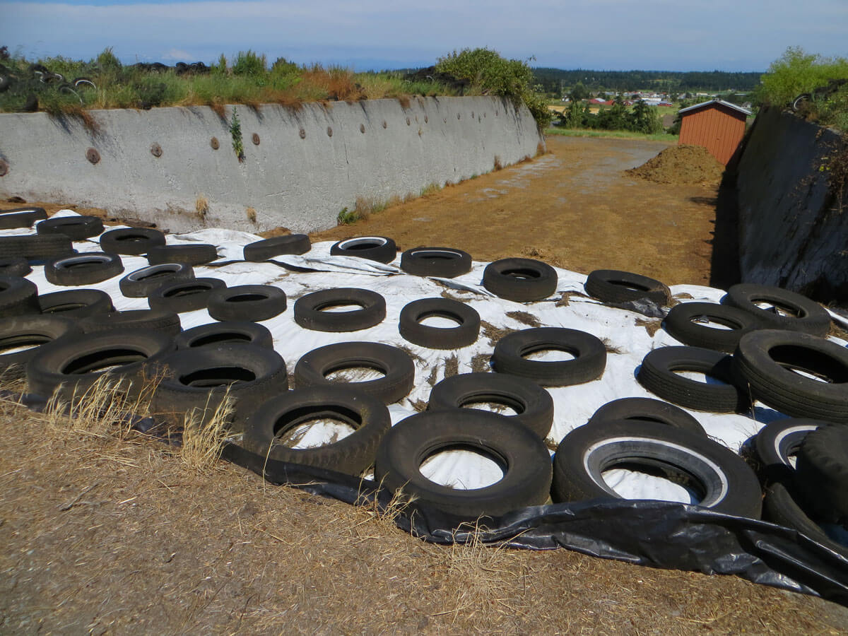 Whole Tire Silage Cover Hold Downs - Converting to 1/2 Tire Slits